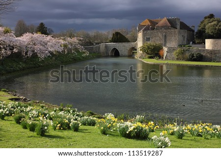 Leeds Castle in Kent, United Kingdom - bridge entrance to the castle in the spring. - stock photo