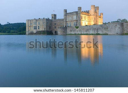Leeds Castle mirrored in surrounding Water - stock photo