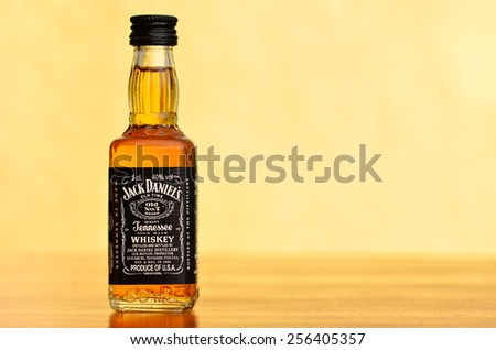 LEEDS - FEBRUARY 27: Jack Daniels whiskey on a faded yellow background. February 27, 2015 in Leeds, UK. - stock photo