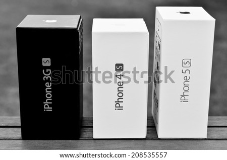 LEEDS - JULY 31: Apple iPhone boxes in a row, image processed in black and white. July 31, 2014 in Leeds, UK - stock photo
