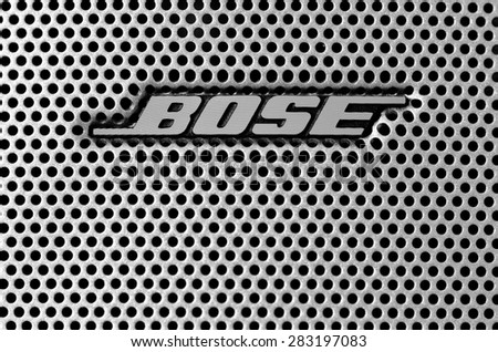 LEEDS - JUNE 01: Bose logo on a speaker grill, image processed in black and white. June 01, 2015 in Leeds, UK. - stock photo