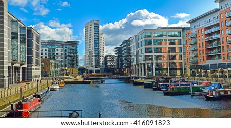 Leeds, The United Kingdom. A view at modern houses by the river of Aire in Leeds.  - stock photo