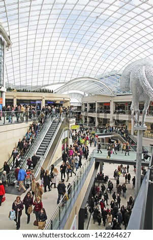 LEEDS, UK - APRIL 4: Shoppers walking through the newly opened Trinity Shopping Centre, Leeds, April 4th, 2013. So far it is the only major shopping mall to open in western Europe in 2013. - stock photo