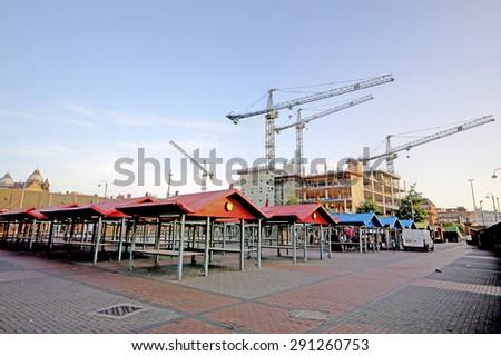 LEEDS, UK - JUNE 6, 2015: Leeds Market. The Leeds City Region is the UK largest economy and population centre outside London, generating 4% of national economic output - stock photo