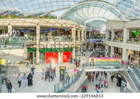 Leeds, UK - September 28, 2014: Shoppers at Trinity Shopping Centre. Housed under a giant iconic glass roof, Trinity Leeds is located in the heart of the city between Briggate and Albion Street. - stock photo