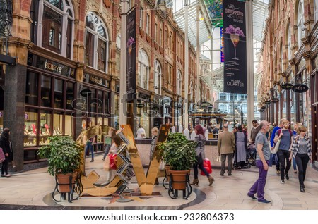 Leeds, UK - September 28, 2014: Shoppers at Victoria Quarter. Situated at the heart of the Leeds shopping area, Victoria Quarter is known as the premium Shopping Centre in the North of England. - stock photo