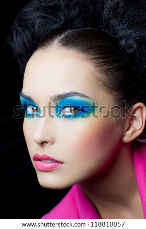 Leer of beautiful girl with bright makeup - stock photo