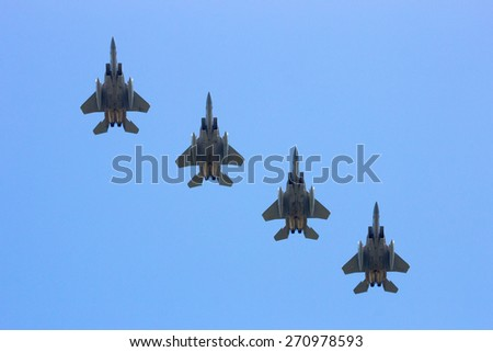 LEEUWARDEN, NETHERLANDS - APRIL 15, 2015: Florida and Oregon ANG F-15 flyby during the exercise Frisian Flag. The exercise is considered one of the most important NATO training events this year. - stock photo