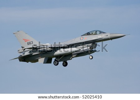 LEEUWARDEN, THE NETHERLANDS - APRIL 12: Norwegian Air Force Lockheed F-16 landing during the exercise Frisian flag 2010. Leeuwarden Airbase april 12, 2010 in Leeuwarden, The Netherlands - stock photo