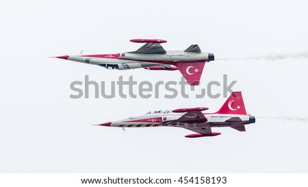 LEEUWARDEN, THE NETHERLANDS - JUNE 10, 2016: Turkish Air Force Demonstration Team Turkish Stars at the Royal Netherlands Air Force Days - stock photo