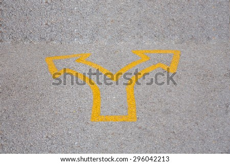Left and right arrow on the road - stock photo