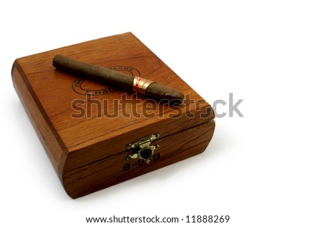left last cigar on brown wooden box - stock photo