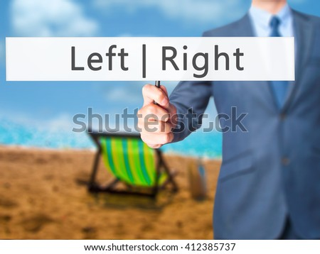 Left Right - Businessman hand holding sign. Business, technology, internet concept. Stock Photo - stock photo