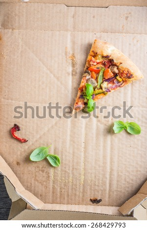 leftovers slices of homemade vegetarian pizza in box from above - stock photo