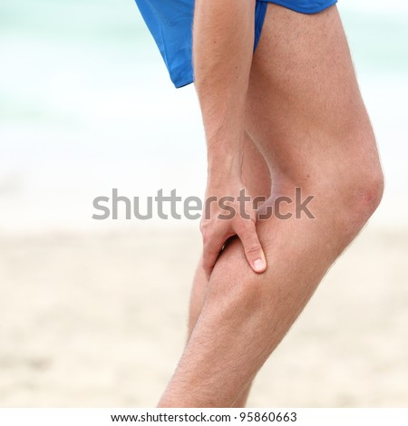 Leg calf sport muscle injury. Runner with muscle pain in leg. - stock photo