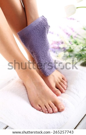 Leg massage.Foot care treatment and nail, the woman at the beautician for pedicure. - stock photo