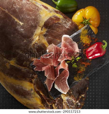 Leg of ham, spanish tapas with green, orange and red pepper - stock photo