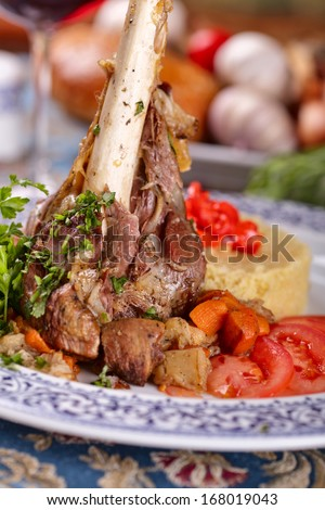 Leg of lamb with couscous - stock photo