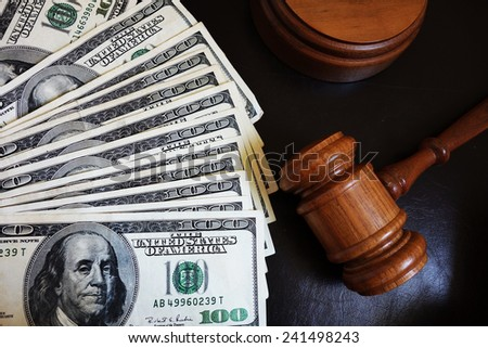 Legal court gavel on assorted cash                                 - stock photo