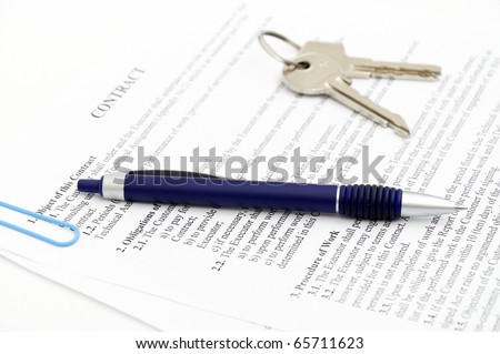 Legal document for sale of real estate property in Europe, with a gold-nibbed fountain pen and house keys - stock photo