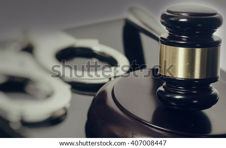 Legal law concept image - gavel and handcuffs  - stock photo