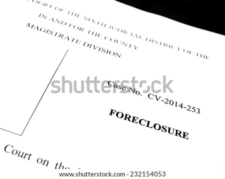 Legal papers for lawsuit of foreclosure on property - stock photo