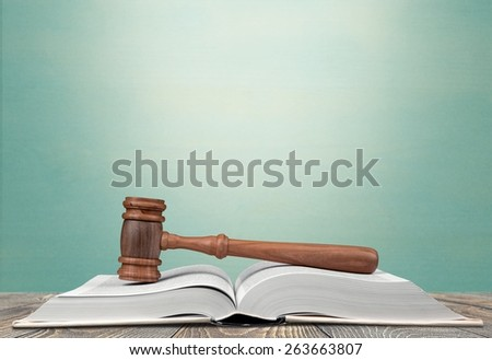 Legal System. Gavel over the opened law book - stock photo