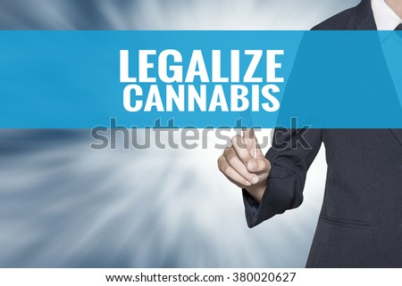 Legalize Cannabis word on virtual screen touch by business woman cyan sky tab - stock photo