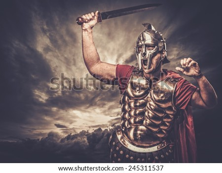 Legionary soldier against stormy sky - stock photo