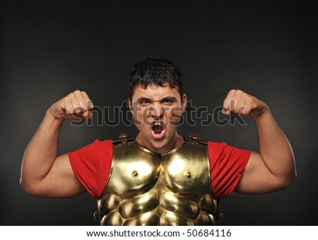 Legionary soldier showing his strength - stock photo