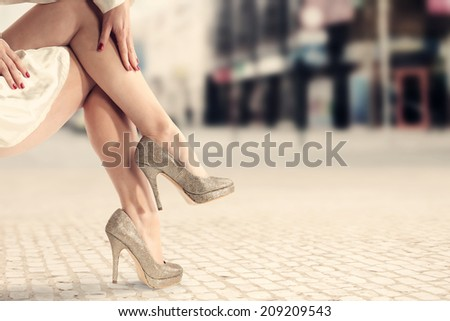 legs and heels of gold  - stock photo
