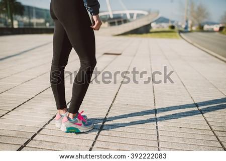 Legs detail of a female runner outdoors - stock photo