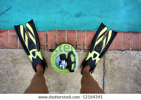 Legs, fins, air tank, training pool. Shot in Sodwana Bay, KwaZulu-Natal province, Southern Mozambique area, South Africa. - stock photo