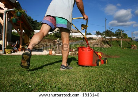 legs mowing the lawn - stock photo