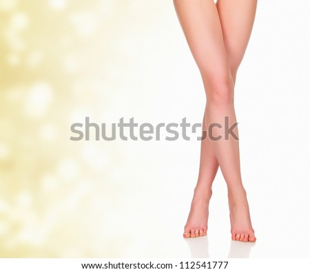 Legs of a woman against abstract background with circles and copyspace - stock photo