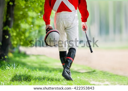 legs of Jockey before walking along the hippodrome track - stock photo