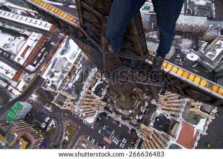 Legs of man on star of residential building on Kudrinskaya Square in Moscow, Russia - stock photo