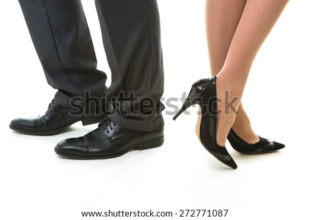 Legs of office clerks on a white background. - stock photo