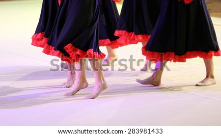 legs of the dancers during the performance of flamenco dance - stock photo