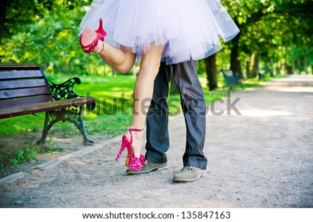 Legs of the groom and the bride. - stock photo