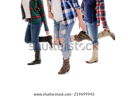 Legs of Three Women in Line Dance Class - stock photo