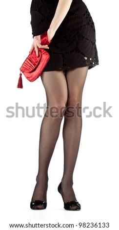 Legs of young woman in mini dress and high heel shoes isolated on white - stock photo