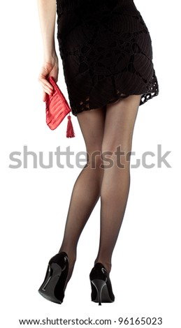 Legs of young woman in mini dress and high heel shoes isolated on white, rear view - stock photo