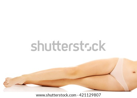 Legs of young woman lying on the floor - stock photo