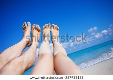 legs on the beach - stock photo