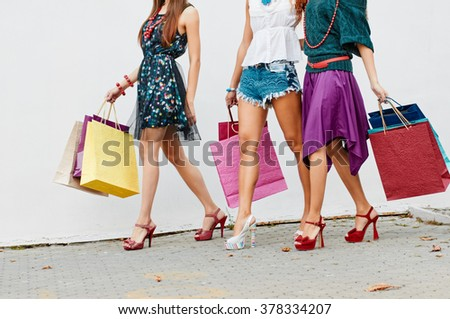 Legs with color bags - stock photo