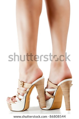 Legs with high heels against a white background - stock photo