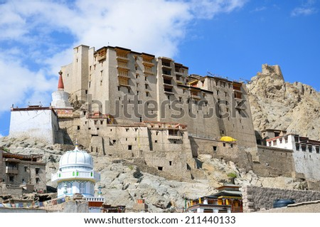 LEH, INDIA - AUGUST 3, 2014:  Leh Palace is a former royal palace that was built by King Sengge Namgyal in the seventeenth century. Potala Palace in Lhasa is modeled on Leh Palace. - stock photo