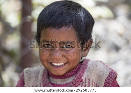 LEH, INDIA - JUNE 26, 2015: Unidentified beggar girl on the street in Leh, Ladakh. Poverty is a major issue in India - stock photo