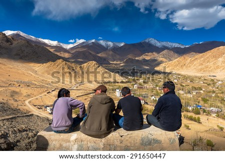 LEH,LADAKH, INDIA - MAY 7:Unidentified Tibetan men siting at viewpoint of Leh city on May 6, 2014 in Leh Ladakh, Northern India. There are many Tibetan refugees living in Ladakh. - stock photo